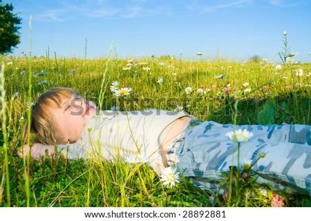child on grass - stock photo