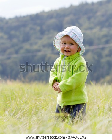 Child on nature in mountain - stock photo