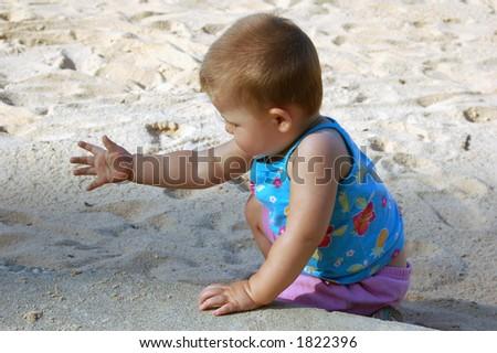 Child on the beach - stock photo