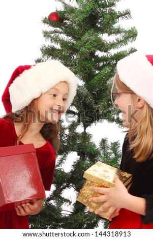 Child opens presents during winter holidays - stock photo