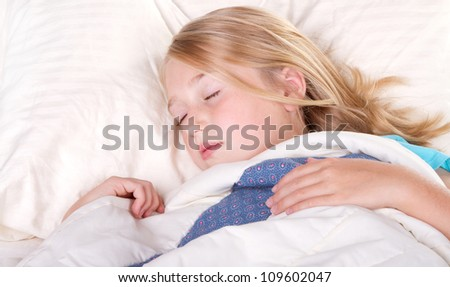 child or teen sleeping in bed - stock photo
