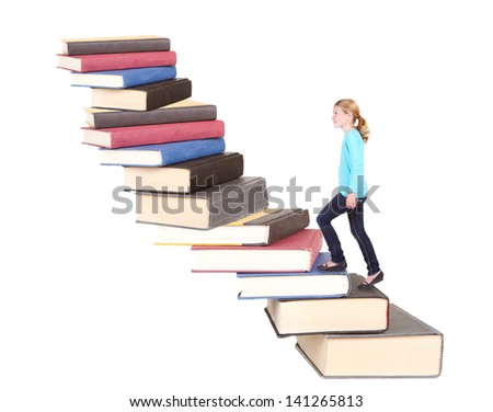 Child or young teen climbing a stair case of books with an isolated white background - stock photo