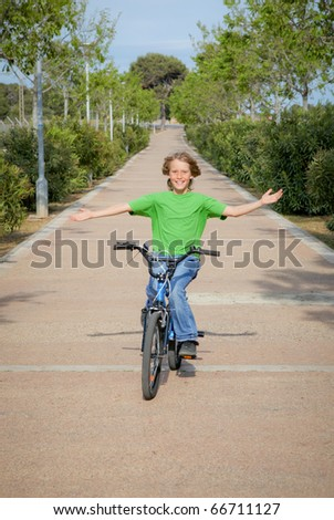 child out playing riding bike or bicycle - stock photo