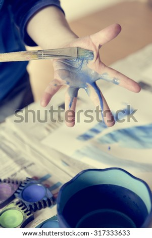 child paint with colors at playschool - stock photo