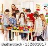 Child painting at art school. Education. - stock photo