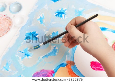 child painting stars, drawing lesson - stock photo