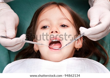 child patient at the dentist - close up - stock photo