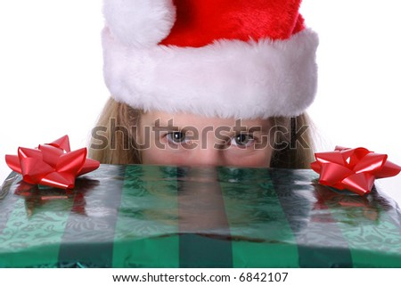 child peeking over a present - stock photo