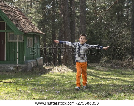 Child play in the forest.  - stock photo
