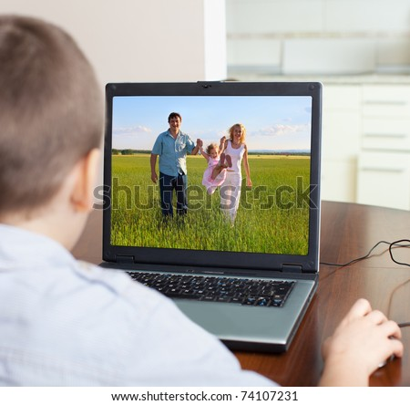 Child playing a computer at home - stock photo