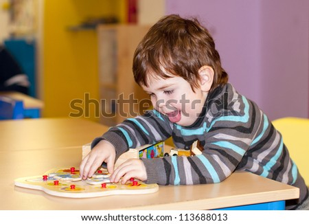 Child playing at kindergarten - stock photo