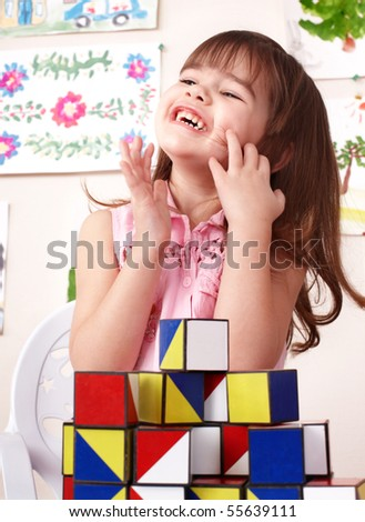Child playing  block in play room. Preschool. - stock photo
