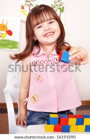 Child playing  block in play room. Preschool. - stock photo
