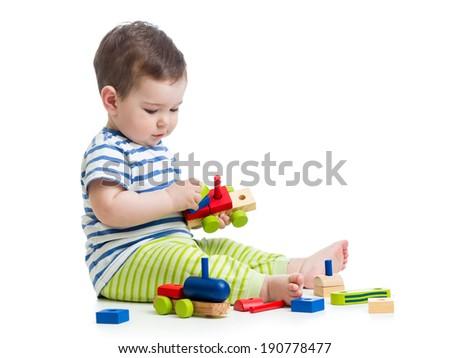 child playing construction set - stock photo