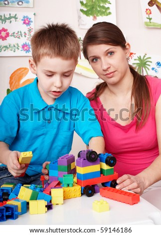 Child playing construction set in games room. Preschool. - stock photo