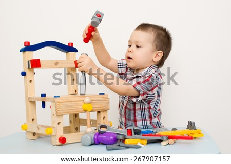 child playing in tools - stock photo
