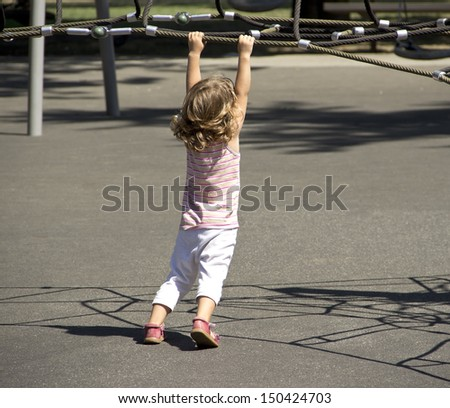 Child playing on the playground - stock photo