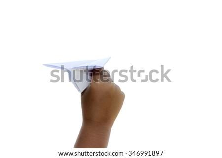 Child playing paper airplane. - stock photo