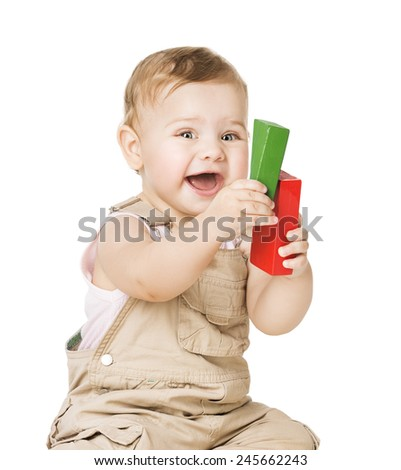 Child Playing Toys Blocks. Happy Baby. Isolated White Background.  - stock photo