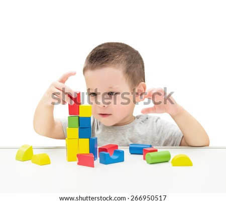 Child Playing Toys Blocks. Isolated White Background. - stock photo