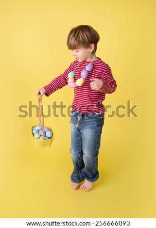 Child playing with an easter egg basket, egg hunt concept. - stock photo