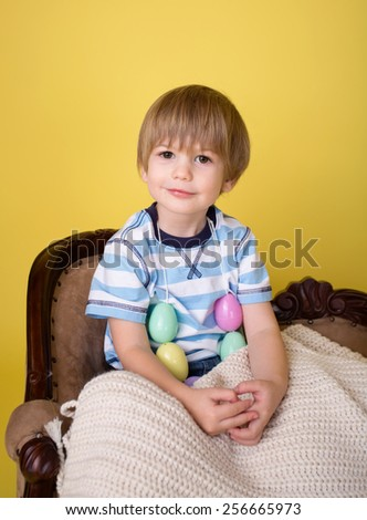 Child playing with an easter egg necklace, easter crafts and activities - stock photo