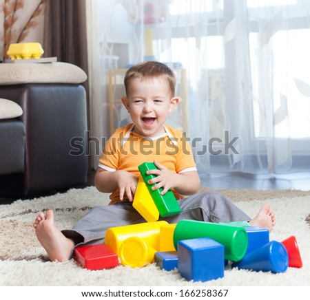 Child playing with building blocks at home. - stock photo