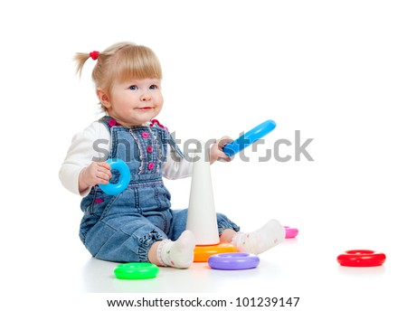 child playing with colour toy pyramid - stock photo