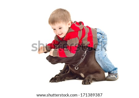 Child playing with dog closes her eyes - stock photo