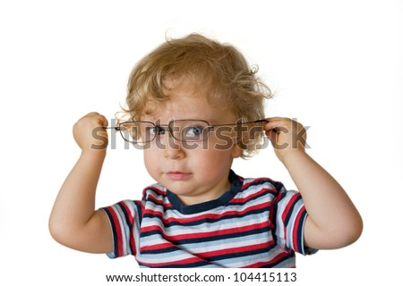 child playing with glasses - stock photo