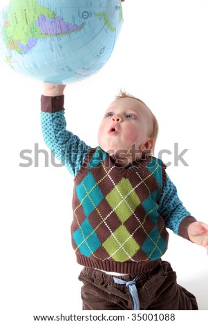 child playing with globe or earth. toddler with planet isolated on white - stock photo