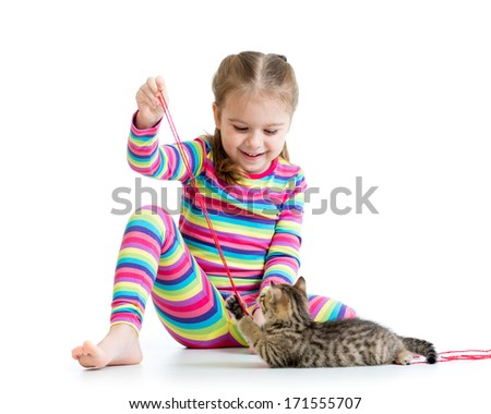 child playing with kittens isolated on white background - stock photo