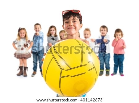 Child playing with soccer ball - stock photo