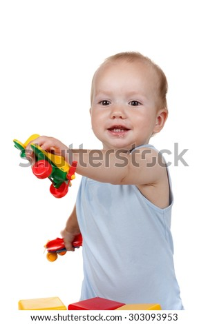 Child playing with toy Aeroplane in a blue dress smiling Studio isolated on white background - stock photo