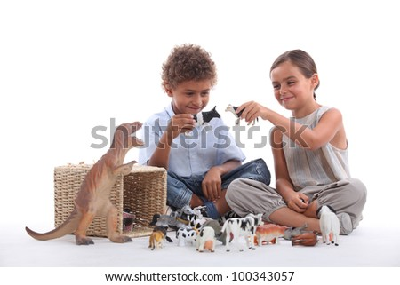 Child playing with toy animals - stock photo