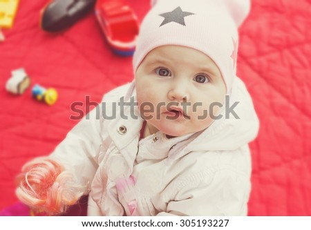 child playing with toys outdoors. carefree childhood. selective focus - stock photo