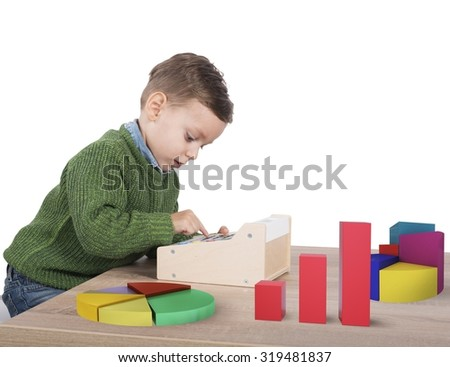Child plays to make calculations and analyzes - stock photo