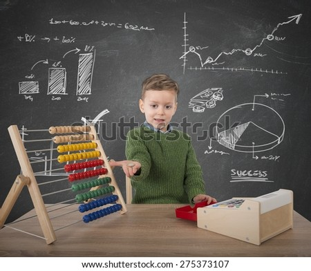 Child plays to make calculations with money - stock photo