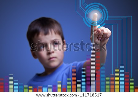 Child pointing to colorful graph on virtual screen - stock photo