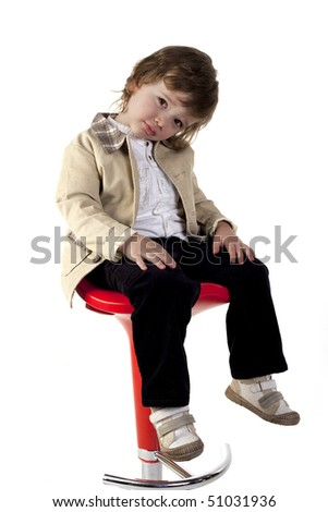 Child posing at camera on a white background - stock photo