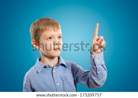 Child pressing a virtual touch pad - stock photo