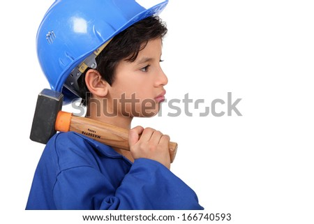 Child pretending to be a construction worker - stock photo