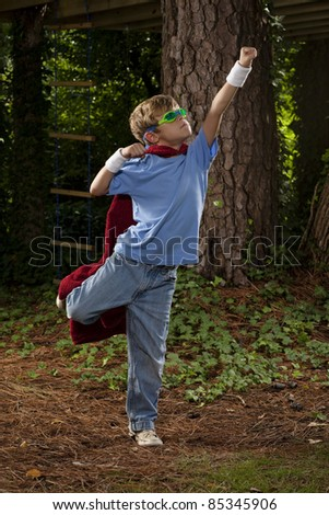 Child Pretending to be a Super Hero - stock photo