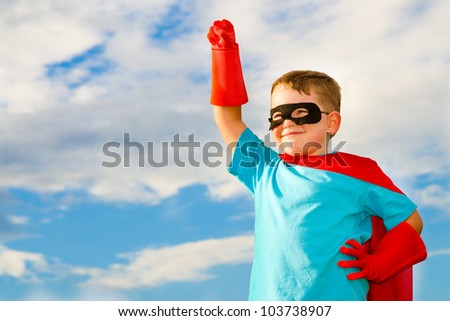 Child pretending to be a superhero - stock photo
