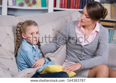 Child psychologist with a little girl, a child is crying - stock photo