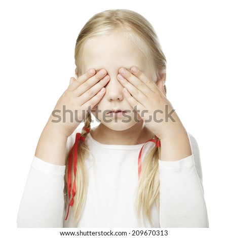 Child puts his hand over his eyes and sees nothing - stock photo