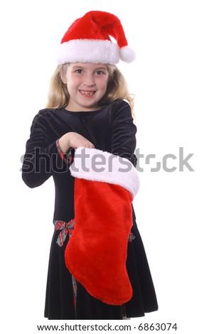 child reaching in stocking - stock photo