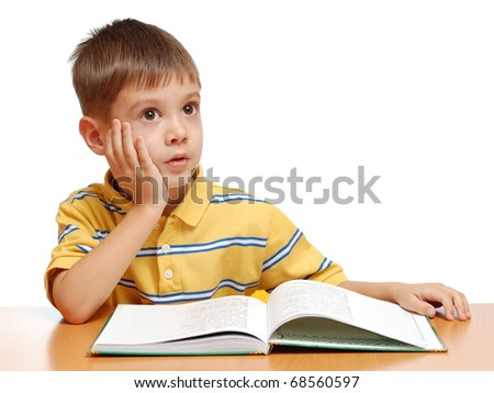 Child reading book and dreaming isolated on white background - stock photo