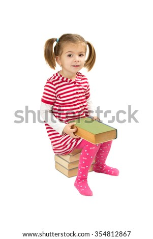 Child reading pile of books. white background - stock photo