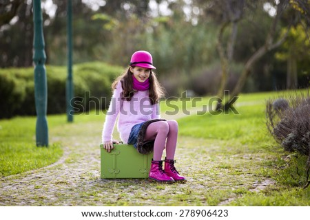 Child ready for travel - stock photo